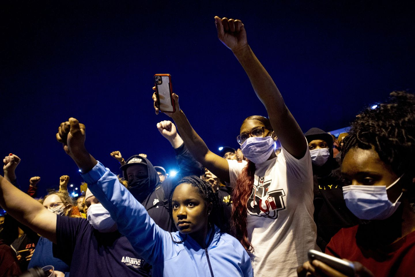 People march at a peaceful protest seeking justice for George Floyd in Flint Township, Michigan.