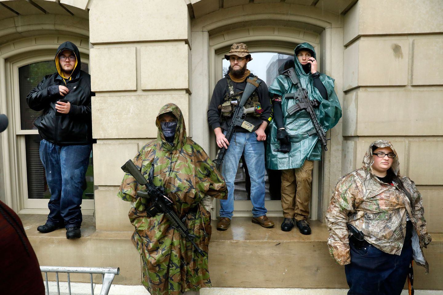 Armed demonstrators in Lansing, Michigan, protest the coronavirus pandemic stay-at-home orders on May 14.