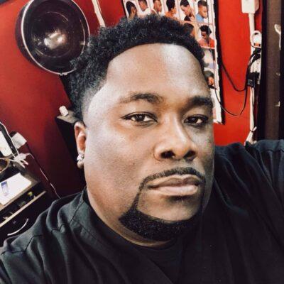Eugene Thompson in a barber shop.