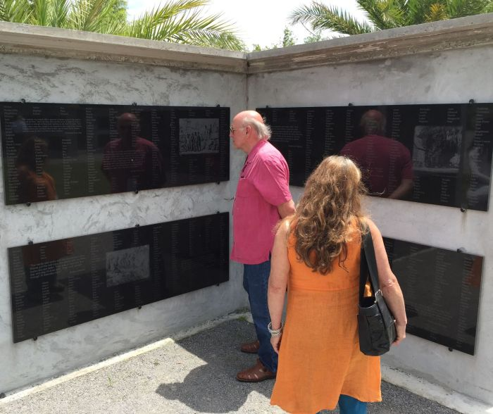 Jim Smith and Paula Barry of Conway, Mass., examined names of Louisiana slaves recorded on the 18 monument walls in the Allées Gwendolyn Midlo Hall at Whitney Plantation.